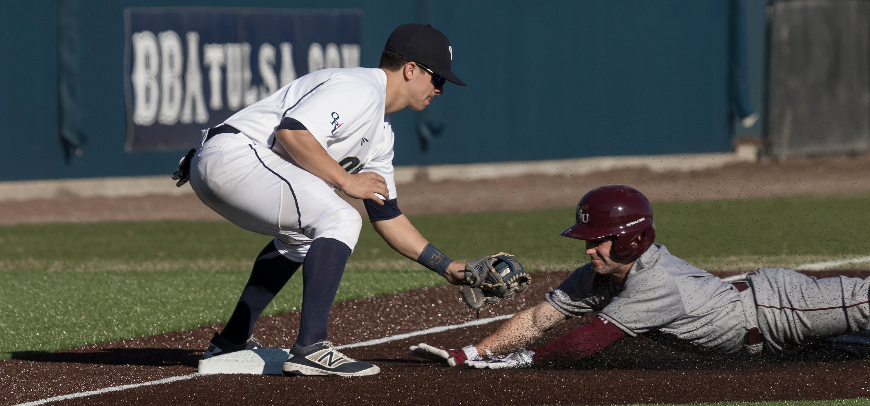 Baseball ORU vs SW Missouri State - Missouri player slides into 3rd base, ORU player tagging him.
