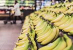 3 Ways to save money on food - picture of bananas in grocery aisle