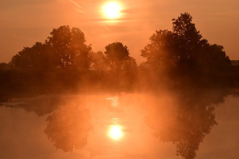 Violence and Faith- Sunrise over a pond