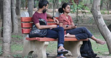 "Couple on a park bench. ""Learning How to Fight Fair"""